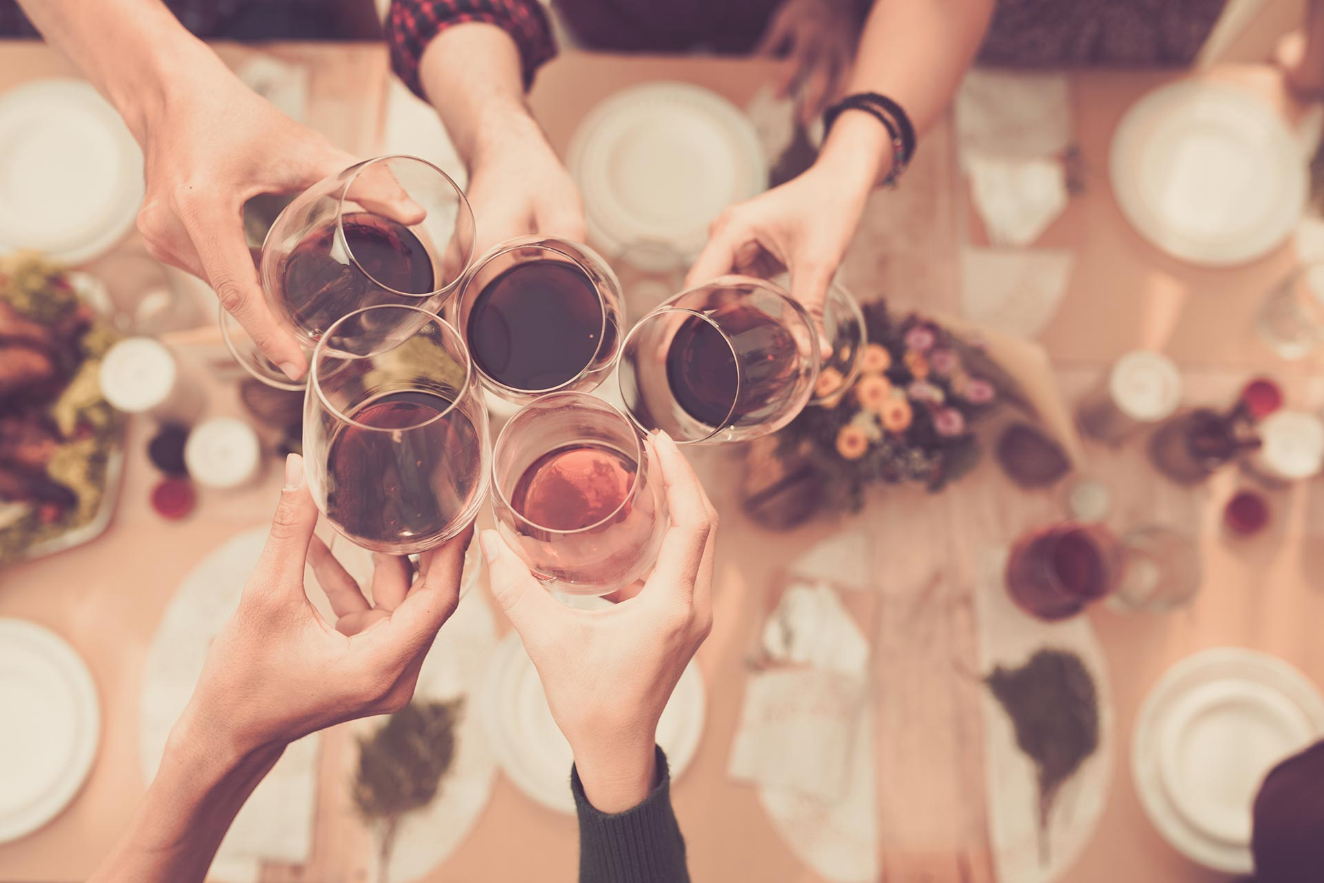 Friends Toasting Wine over Dinner